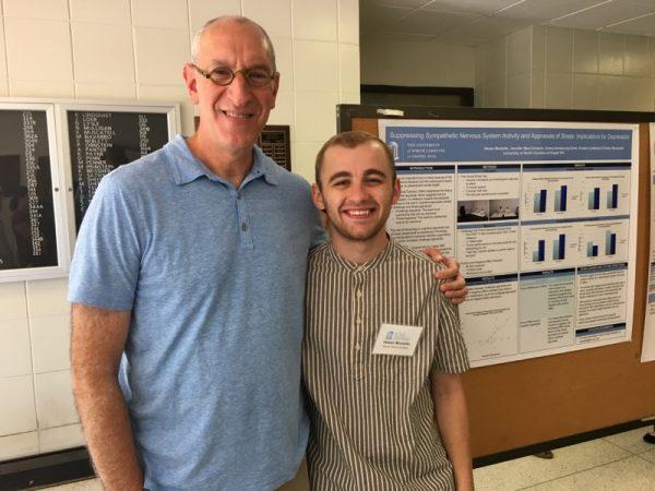 Dr. Penn with undergraduate Hasan Mustafic at UNC psychology poster presentation